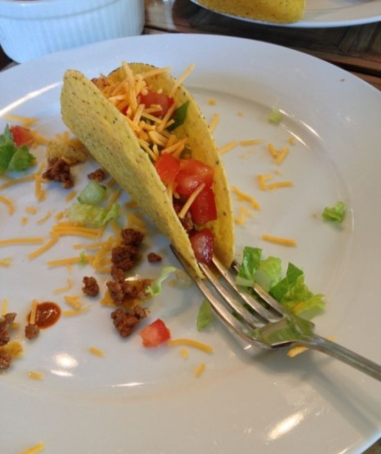 Stand up a taco using a fork for easy filling.